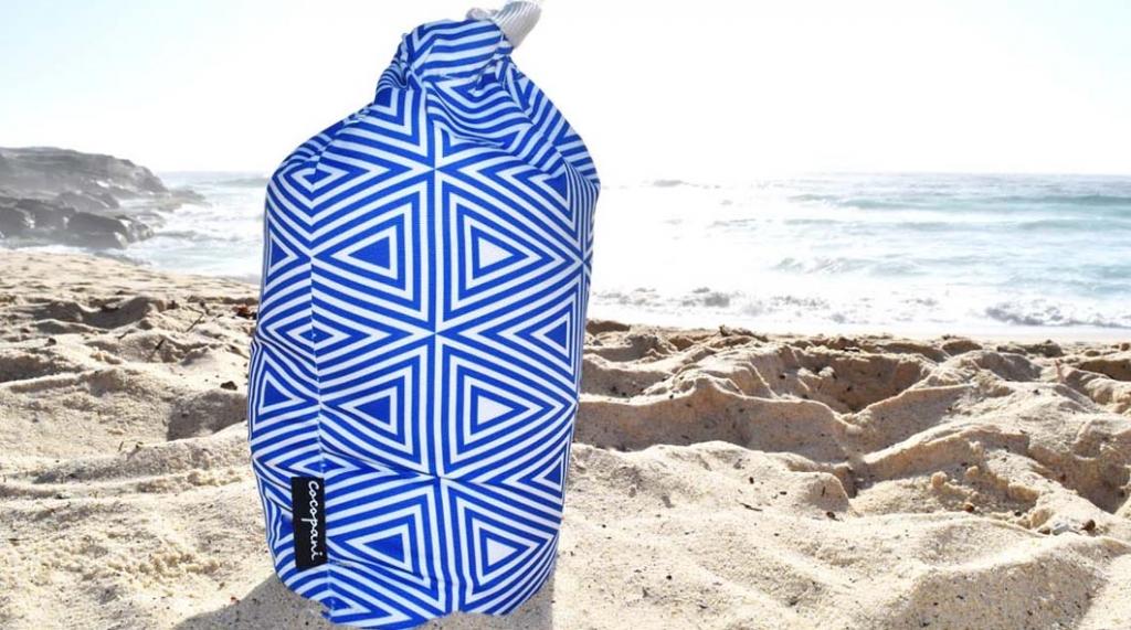 Cocopani Aztek sandbag full of sand at the beach